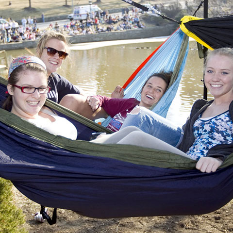 students in hammocks by the duck pond