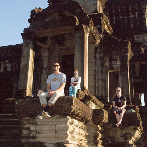 students visiting ruins in Asia